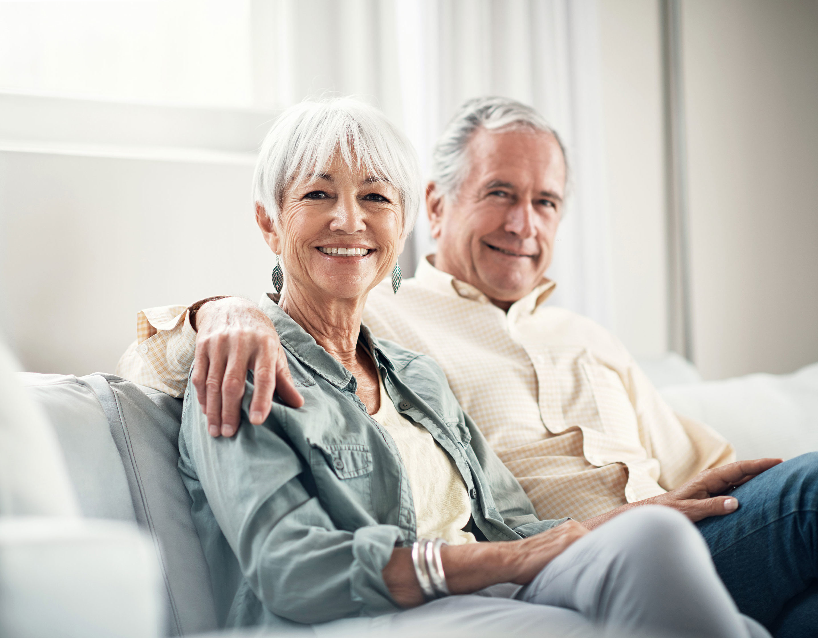mature couple sitting on couch